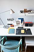 Books, souvenirs and retro decorations on desk