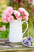 Bouquet of roses in milk jug
