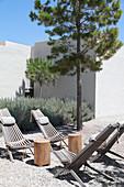 Deckchairs in gravel courtyard