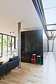 Cubist steel structure and skylights in open-plan interior of modern, architect-designed house