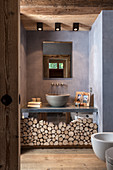 Mirrored washstand base cabinet decorated with log pieces