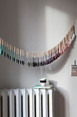 Garland of wooden spoons dipped in paint with colour gradient