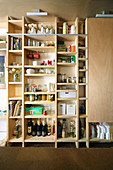 Groceries on shelves with sliding plywood door