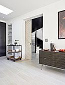 Sideboard with honeycomb front and serving trolley flanking sliding door