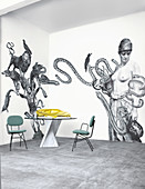 Black and white collage on wall, designer table and chairs
