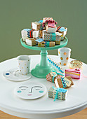 Numbered gifts wrapped in colourful paper on cake stand