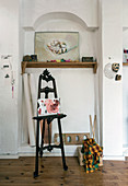 Antique easel and artists utensils in niche