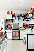 White kitchen with metal worksurfaces on steel frame