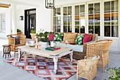 Rattan sofa and wicker chairs in seating area on veranda