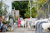 Terrace with seating area and hanging chair in December