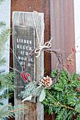 Miniature Christmas wreath on terrace