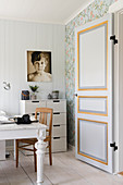 Painted panelled door leading into hobby room in Scandinavian country-house style