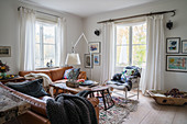 Brown leather sofas in cosy living room
