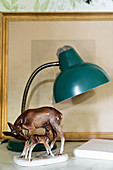 Porcelain deer and kid, table lamps and picture frame