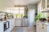 Kitchen in classic country-house style with white cabinets