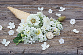 Ice cream cone with white flowers