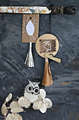 Handmade mobile of tassels, paper pendants, owls and sprig of honesty