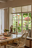 View from country-house-style dining room into summery garden