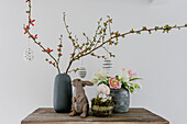 Easter arrangement of flowering quince branches, tulips and ranunculus
