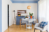 White Tulip Table and blue sideboard in dining area