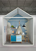 Creative idea for kitchen area with blue sink unit against artistic mural wallpaper