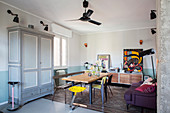 Dining table, sideboard and sofa in retro living space