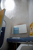 Yellow and blue bathroom with organically formed walls