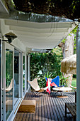 Classic chairs and table on roofed veranda