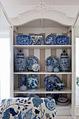 Blue-and-white china in cupboard