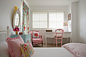 Pink chairs and white desk in girl's bedroom