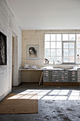 Industrial-style tabletop and chest of drawers below lattice window