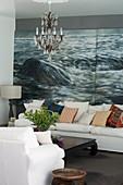 Scatter cushions on white sofa against maritime mural wallpaper