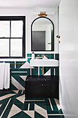 Bathroom with teal and white tiles