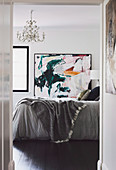 View of double painting on modern painting in bedroom