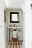 Marble vanity, above wall mirror in guest toilet