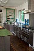 Vintage-style stainless steel kitchen with green and blue accents