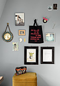 Pictures, photos, cloth bag with message and clock on grey wall