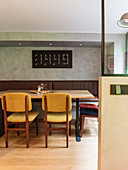 Digital wall clock in retro dining area