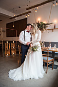 Bride and groom in vintage-style restaurant