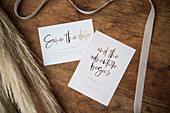 Wedding cards on wooden surface