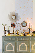 Lavish, vintage-style arrangement of Christmas decorations on sideboard