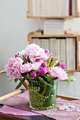 Glass vase of pink peonies