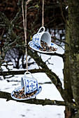 DIY bird feeders made from teacups and saucers