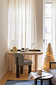 Upholstered chair at dressing table in guest room with Christmas decorations