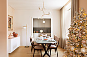 Christmas tree in elegant dining room in champagne shades