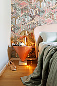 Conical bedside table and designer lamp in bedroom