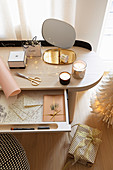 Stationary in open drawer of modern dressing table