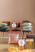 Chairs with velvet upholstery, cushions, table lamps and gifts