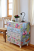 Redesign: wooden chest of drawers covered with floral wallpapers