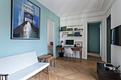 Pale blue wall in connecting room in French period building